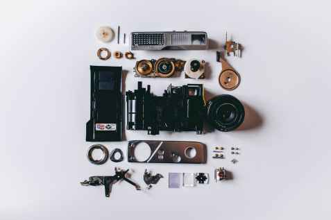 flat lay photography of parts of camera